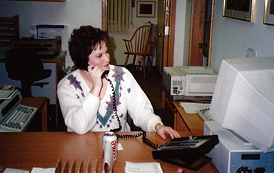 Judy on phone in office